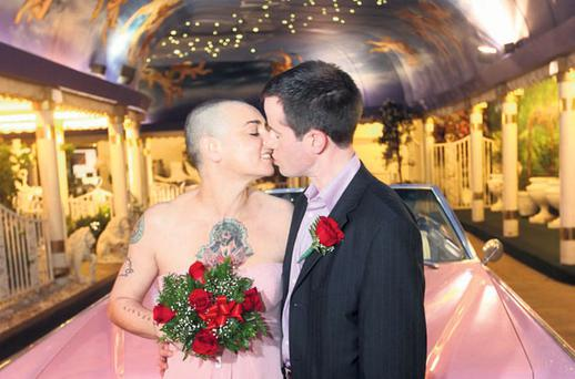 Sinead and Barry outside the wedding chapel in Las Vegas and with the pink Cadillac in which they got married