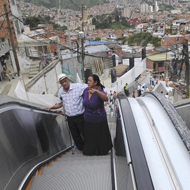 Residents use outdoor escalators, newly installed at Comuna 13 shantytown in Medellin, Colombia (AP/Luis Benavides)
