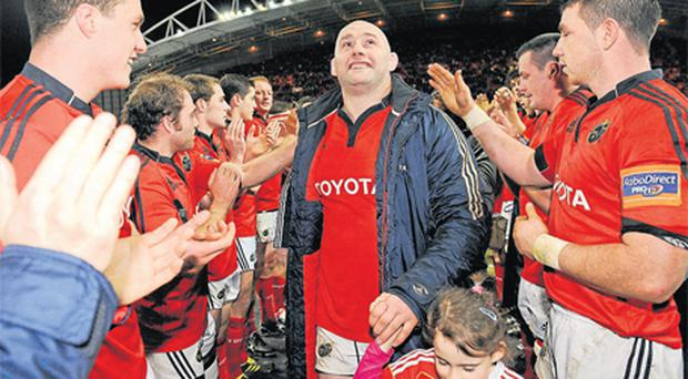 John Hayes accompanied by his five-year-old daughter Sally is applauded off the pitch by his team-mates after the game against Connacht on St Stephen's Day. Photo: Sportsfile
