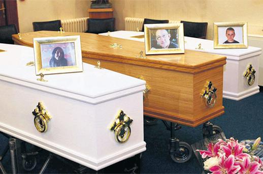 Coffins containing the bodies of Trevor Wallwork and his two children at a memorial service in the Nazareth House Chapel, Church Hill, Sligo, yesterday