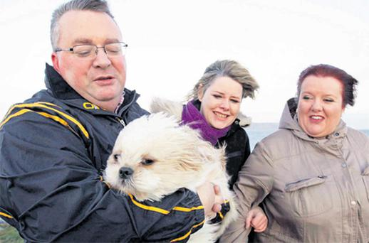 Martin O'Shea, Lisa Forde, Margaret McCarthy and Fi Fi the dog braving the high wind on Dollymount Strand in Dublin