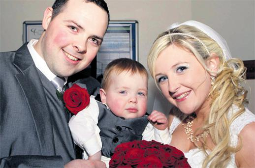 Proud parents Shaun Boyce and Amy Haughey with their son Jamie after the couple were married in Ardara, Co Donegal, yesterday
