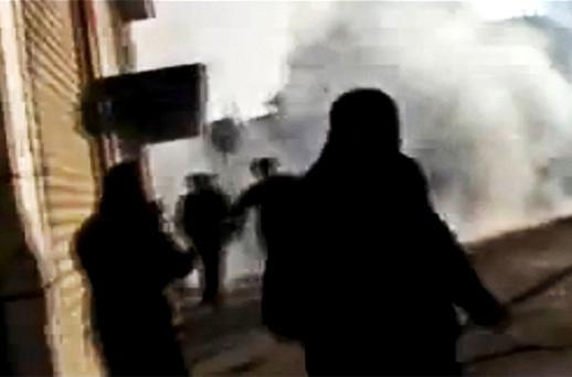 Protesters run from tear gas during clashes in Homs. Photo: AP