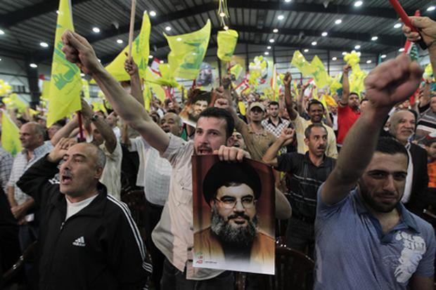 Hezbollah supporters shout slogans during a speech by party leader Hassan Nasrallah. Photo: Getty Images