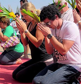 Rory McIlroy and his girlfriend, tennis star Caroline Wozniacki, visiting a temple in Hua Hin, Thailand, yesterday