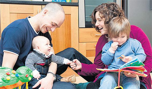 Dad Stewart Whitney, four-month-old Myles, Conor (2) and mum Sonia Walker in their home in Tallaght, Dublin