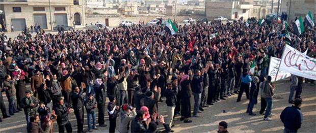 Demonstrators protesting against Syria's President Bashar al-Assad march through the streets in Ma'arrat al-Numan