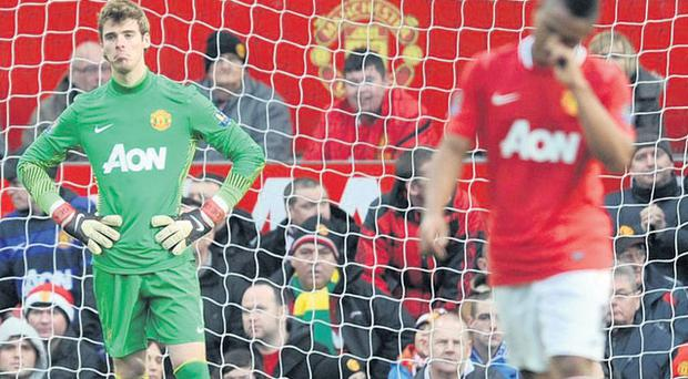 Manchester United's David De Gea stands dejected after Blackburn Rovers' winning goal at Old Trafford yesterday