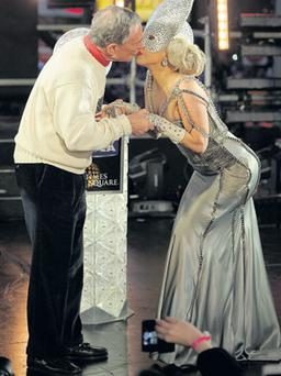 New York Mayor Michael Bloomberg kisses Lady Gaga during the Big Apple celebrations in which Gaga also sang