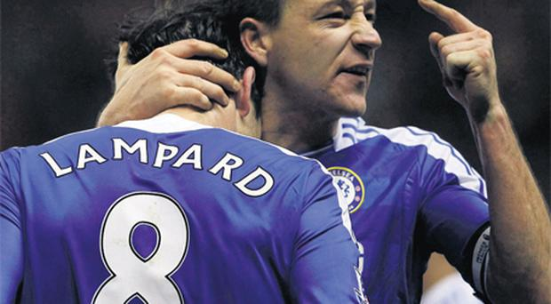 John Terry embraces his Chelsea team-mate Frank Lampard after his last-gasp winner