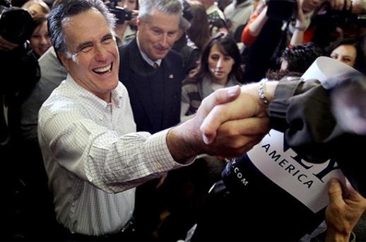 Mitt Romney greets a supporter in Council Bluffs, Iowa. Photo: Getty Images