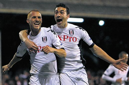 Steve Sidwell celebrates with Stephen Kelly after scoring Fulham's first goal at Craven Cottage last night