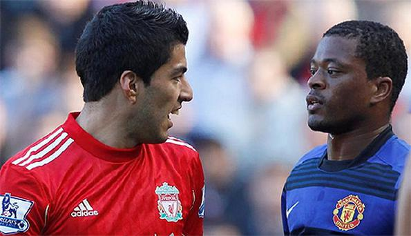 Luis Suarez clashes with Patrice Evra at Anfield