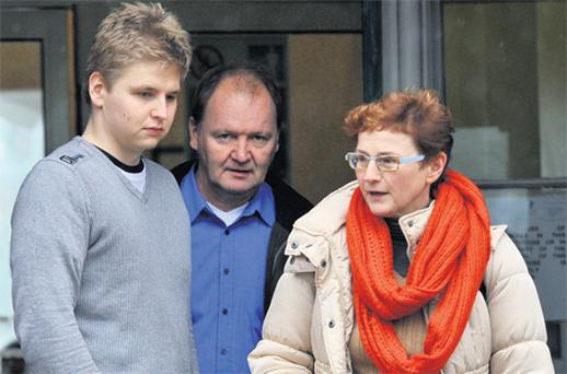 Janne Geohannes Lindroos with his parents, who flew in from Finland to support him, outside Cork District Court yesterday.