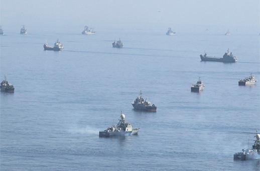 Iranian ships participate in a naval parade on the last day of war games on the Sea of Oman near the Strait of Hormuz in southern Iran yesterday. Photo: Reuters