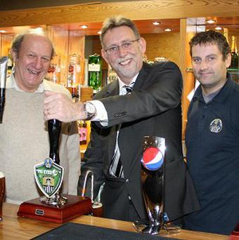 Notts County chairman Ray Trew pulls the first pint of Pie Eyed 150, watched by Eric Jackson (left) and Castle Rock Brewery's Colin Wilde (Castle Rock Brewery/PA)