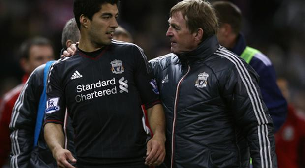 Luis Suarez and Kenny Dalglish. Photo: Getty Images
