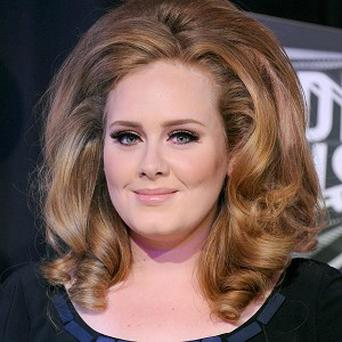 Adele's best-selling album 21 sold almost four million copies last year