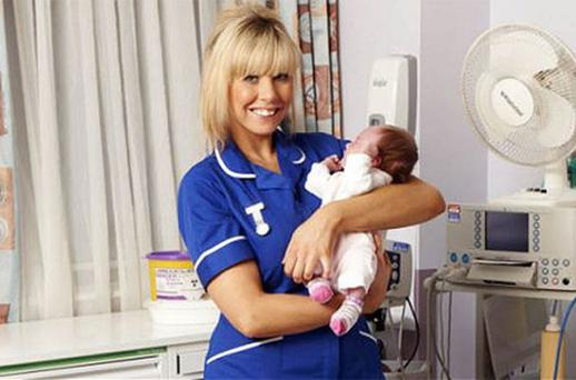A nurse holds a newborn baby on the maternity ward at Leeds General Infirmary in the Chanel 4 series One Born Every Minute. Photo: Channel 4