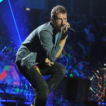 Chris Martin's Coldplay secured the first number one of 2012 with their single Paradise