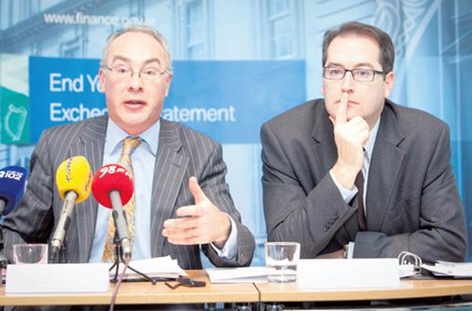 Assistant Secretary Michael McGrath and Principal Officer Ronnie Downes during yesterday's media briefing on the 2011 Exchequer Statement at The Department of Finance in Dublin. Photo: Collins