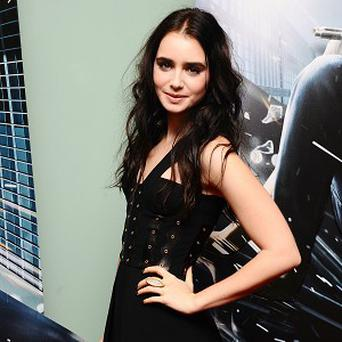Lily Collins is reportedly in talks to star in the Evil Dead remake