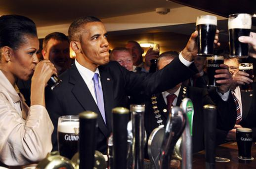 US President Barack Obama and First Lady Michelle sip Guinness at a pub as they visit Moneygall in County Offaly - it's unlikely they have difficulties getting served at a bar