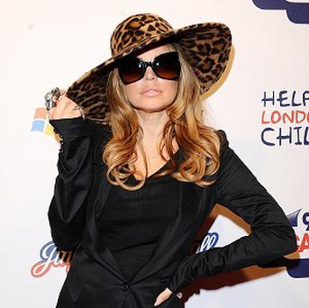 Fergie is hoping to spend more time with her husband in 2012
