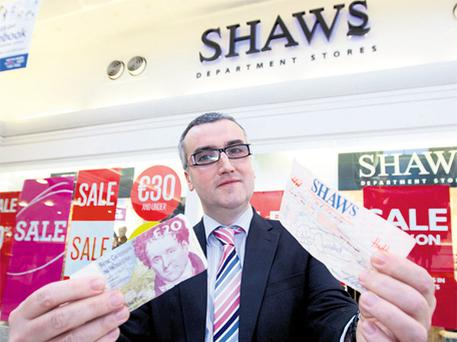 Shaws manager Joe Meagher with the IR£33 voucher and a £20 note