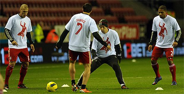 Liverpool players wear t-shirts in support of Luis Suarez during the warm-up before a Premier League game. Photo: Getty Images
