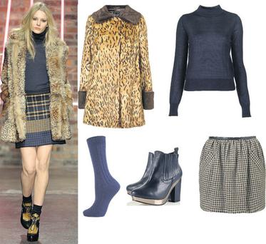 Faux fur coat, €147; jumper, €63; skirt, €57; socks, €5 and boots, €120 all at Topshop.com