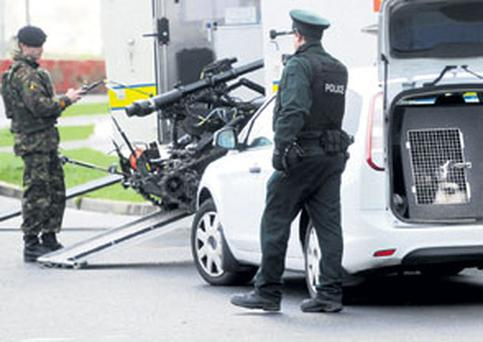 Security forces deal with a booby trap bomb in a soldier's car in north Belfast yesterday