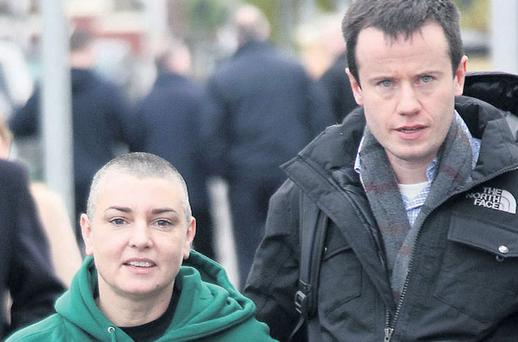 LOVED UP: Sinead O'Connor and her husband Barry Herridge together in Dublin last week