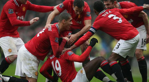 Manchester United's Danny Welbeck is congratulated by team-mates after scoring his sides second goal of the game during the FA Cup, Third Round match at the Etihad Stadium, Manchester. Photo: PA