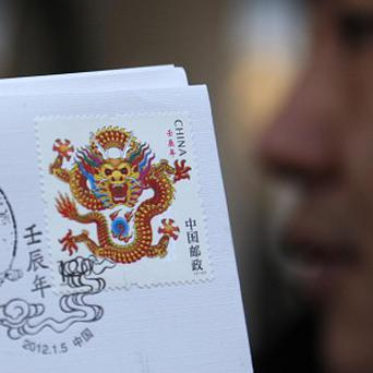 A designer has received criticism, abuse and support for his new dragon stamp in China (AP)