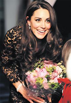 Kate Middleton turns 30 today but was lavished with best wishes and roses, as our picture shows, when she attended last night's gala premiere of Steven Spielberg's film 'War Horse' in London.