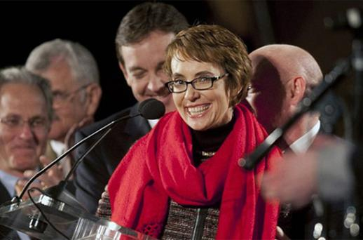 Arizona Representative Giffords smiles after reciting the Pledge of Allegiance at a memorial service. Photo: Reuters