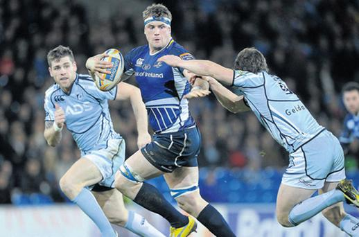 Jamie Heaslip holds off Lloyd Williams before setting up Sean O'Brien for Leinster's first try against Cardiff Blues