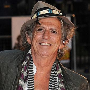 Keith Richards will not have to wear glasses after the operation