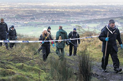 Gardai at the scene where skeletal remains were found by hill walkers off the old Military Road in the Dublin mountains on Sunday