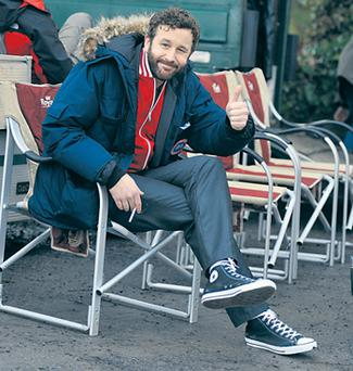 Chris O'Dowd relaxing on set
