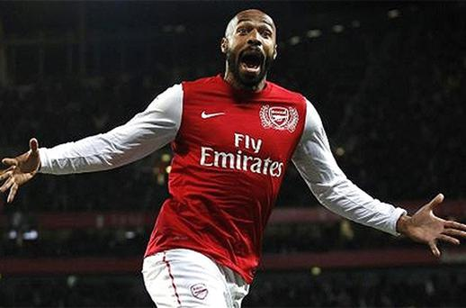 Thierry Henry celebrates after coming off the bench for Arsenal to break the deadlock against Leeds United. Photo: Reuters