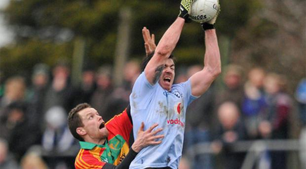 Dublin's Michael Darragh Macauley (left), here being challenged by Brian Murphy, has an All Star to his name while Carlow's Brendan Murphy is facing into a campaign in Division 4 of the league