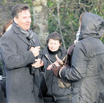 Daniel O'Donnell waits with other residents of the town to pay his respects