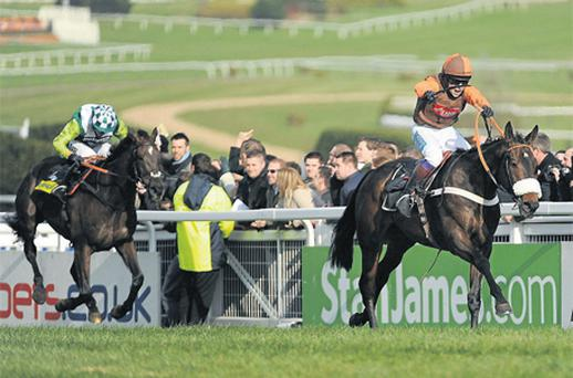 Long Run and Sam Waley-Cohen on the way to winning last year's Gold Cup from Denman, but has the race taken its toll?