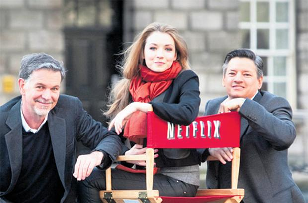 Netflix founder and CEO Reed Hastings; Sarah Bolger, star of 'In America' and 'The Tudors', and Ted Sarandos, Netflix chief content officer, at the launch of the film streaming company in Ireland at Trinity College, Dublin, this week