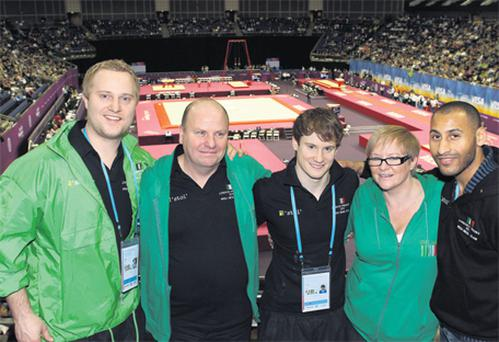 Irish gymnast Kieran Behan (centre) with his parents Phil and Bernie, and coaches Simon Gale (left) and Dimitrios Bradshaw (right) at North Greenwich Arena in London yesterday