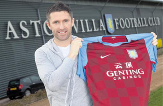 Robbie Keane shows his new colours at Villa Park yesterday