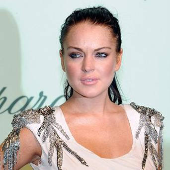 Lindsay Lohan is facing court action over nearly 94,000 US dollars that the federal government says she owes in unpaid taxes