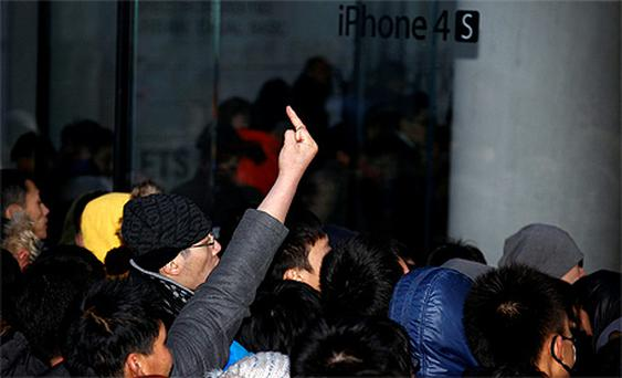An angry mob gathers outside Beijing's flagship Apple store